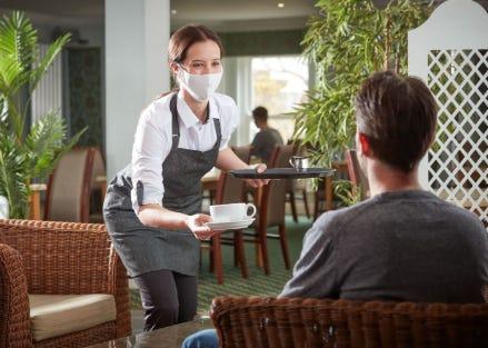 Waitress serving a man