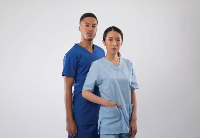 Two nurses wearing Alexandra Workwear scrubs
